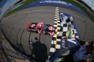 2013 NCWTS Driver Jame Buescher Takes the Checkered Flag in the Michigan National Guard 200 - Photo Credit: Getty Images