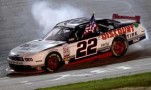 Brad Keselowski, driver of the #22 Discount Tire Ford, celebrates after winning - Photo Credit: Sean Gardner/Getty Images