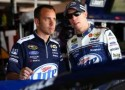 (R-L) Brad Keselowski, driver of the #2 Miller Lite Ford, talks with crew chief Paul Wolfe in the garage - Photo Credit: Tom Pennington/Getty Images