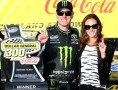 Kyle Busch, driver of the #54 Monster Energy Toyota, celebrates with his wife Samantha in Victory Lane after winning the NASCAR Nationwide Series Dollar General 300 Powered by Coca-Cola at Chicagoland Speedway on September 14, 2013 in Joliet, Illinois. - Photo Credit: Todd Warshaw/Getty Images