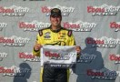 Sam Hornish Jr, driver of the #12 Alliance Truck Parts Ford holds the pole award for the NASCAR Nationwide Series Kentucky 300 at Kentucky Speedway on September 21, 2013 in Sparta, Kentucky. - Photo Credit: Andy Lyons/Getty Images
