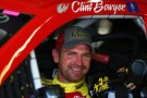 Clint Bowyer, driver of the #15 5-hour ENERGY Toyota, sits in his car - Photo Credit: Todd Warshaw/Getty Images