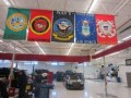 Flags of the five U.S. military branches are proudly on display at the Furniture Row Racing shop in Denver, Colo.