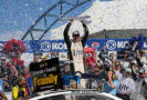 Brad Keselowski, driver of the #2 Miller Lite Ford, celebrates in Victory Lane after winning the NASCAR Sprint Cup Series Kobalt 400 at Las Vegas Motor Speedway on March 9, 2014 in Las Vegas, Nevada. - Photo Credit: Jerry Markland/Getty Images