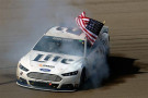 Brad Keselowski, driver of the #2 Miller Lite Ford, celebrates with a burnout after winning the NASCAR Sprint Cup Series Kobalt 400 at Las Vegas Motor Speedway on March 9, 2014 in Las Vegas, Nevada. - Photo Credit: Jared C. Tilton/Getty Images