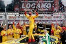 Joey Logano, driver of the #22 Shell-Pennzoil/Hertz Ford, celebrates in Victory Lane after winning the NASCAR Sprint Cup Series Duck Commander 500 at Texas Motor Speedway on April 7, 2014 in Fort Worth, Texas. - Photo Credit: Chris Graythen/Getty Images