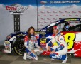 Jimmie Johnson, driver of the #48 Lowe's Patriotic Chevrolet, poses with Rachel Rupert, Miss Coors Light, after qualifying for the pole position for the NASCAR Sprint Cup Series Coca-Cola 600 at Charlotte Motor Speedway on May 22, 2014 in Charlotte, North Carolina. (May 21, 2014 - Source: Matt Sullivan/Getty Images