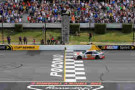 Dale Earnhardt Jr., driver of the #88 National Guard Chevrolet, takes the checkered flag to win the NASCAR Sprint Cup Series Pocono 400 at Pocono Raceway on June 8, 2014 in Long Pond, Pennsylvania. - Photo Credit: Daniel Shirey/Getty Images