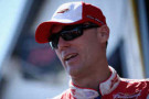 Kevin Harvick, driver of the #4 Budweiser Chevrolet, looks on in the garage area during practice for the NASCAR Sprint Cup Series Pocono 400 at Pocono Raceway on June 7, 2014 in Long Pond, Pennsylvania. - Photo Credit: Doug Pensinger/Getty Images