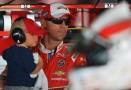 2014 NSCS Driver Kevin Harvick with son Keelan in the garage area - Photo Credit: Drew Hallowell/Getty Images