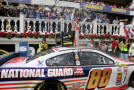 Dale Earnhardt Jr., driver of the #88 National Guard Chevrolet, celebrates in Victory Lane after winning the NASCAR Sprint Cup Series Pocono 400 at Pocono Raceway on June 8, 2014 in Long Pond, Pennsylvania. - Photo Credit: Jerry Markland/Getty Images