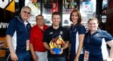 Jamie McMurray Poses with Executives from Edible Arrangements