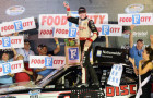 Ryan Blaney, driver of the #22 Discount Tire Ford, celebrates in Victory Lane after winning the NASCAR Nationwide Series Food City 300 at Bristol Motor Speedway on August 22, 2014 in Bristol, Tennessee. - Photo Credit: Patrick Smith/Getty Images