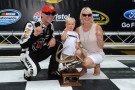 Kevin Harvick, driver of the #4 Jimmy John's Chevrolet, poses with his wife DeLana, son Keelan, and the pole award after qualifying fastest for the NASCAR Sprint Cup Series Irwin Tools Night Race at Bristol Motor Speedway on August 22, 2014 in Bristol, Tennessee. - Photo Credit: Rainier Ehrhardt/Getty Images