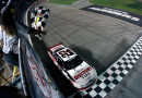Brad Keselowski, driver of the #22 Discount Tire Ford, wins the Nationwide Series U.S. Cellular 250 at Iowa Speedway on August 2, 2014 in Newton, Iowa. - Photo Credit: Brian Lawdermilk/Getty Images
