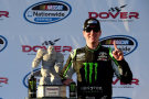 Kyle Busch, driver of the #54 Monster Energy Toyota, celebrates in Victory Lane after winning the NASCAR Nationwide Series Dover 200 at Dover International Speedway on September 27, 2014 in Dover, Delaware. - Photo Credit: Patrick Smith/Getty Images
