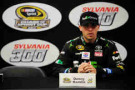 Denny Hamlin, driver of the #11 FedEx Ground Toyota, speaks at a press conference following practice for the NASCAR Sprint Cup Series Sylvania 300 at New Hampshire Motor Speedway on September 19, 2014 in Loudon, New Hampshire. - Photo Credit: Will Schneekloth/Getty Images