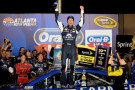 Kasey Kahne, driver of the #5 Farmers Insurance Chevrolet, celebrates in Victory Lane after winning the NASCAR Sprint Cup Series Oral-B USA 500 at Atlanta Motor Speedway on August 31, 2014 in Hampton, Georgia. - Photo Credit: Jonathan Moore/Getty Images