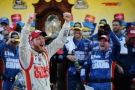 Dale Earnhardt Jr., driver of the #88 National Guard Chevrolet, celebrates in Victory Lane after winning during the NASCAR Sprint Cup Series Goody's Headache Relief Shot 500 at Martinsville Speedway on October 26, 2014 in Martinsville, Virginia. - Photo Credit: Jonathan Moore/Getty Images