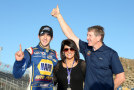 Chase Elliott, driver of the #9 NAPA Auto Parts Chevrolet, celebrates with his father, Hall of Fame driver Bill and mother Cindy after winning the NASCAR Nationwide Series Championship following his fifth place finish in the DAV 200 at Phoenix International Raceway on November 8, 2014 in Avondale, Arizona. - Photo Credit: Todd Warshaw/Getty Images