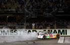 Matt Kenseth, driver of the #20 GameStop/Rock Candy Toyota, celebrates with a burnout after winning the NASCAR Nationwide Series Ford EcoBoost 300 at Homestead-Miami Speedway on November 15, 2014 in Homestead, Florida. - Photo Credit: Chris Graythen/Getty Images