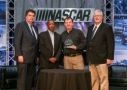 L to R = Mike Helton, NASCAR President; Mike Phillips, Director, NASCAR Track Services; Tony Morgan, Fire and Safety Manager, Kentucky Speedway; David Hoots, Managing Event Director, NASCAR Race Services (Photo Credit: Scott Hunter / NASCAR)