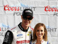 Joey Logano (L), driver of the #22 Discount Tire Ford, poses for a photo with Miss Coors Light Rachel Rupert after qualifying for the NASCAR XFINITY Series Hisense 250 at Atlanta Motor Speedway on February 28, 2015 in Hampton, Georgia. - Photo Credit: Kevin C. Cox/Getty Images