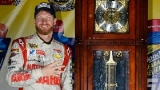 2014 NSCS Driver Dale Earnhardt Jr., Stands Next to the Martinsville Speeway Grandfather Clock after Winning the Goody's Headache Relief Shot 500 - Photo Credit: Robert Laberge/Getty Images