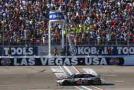 Kevin Harvick, driver of the #4 Jimmy John's/Budweiser Chevrolet, crosses the finishline to win the NASCAR Sprint Cup Series Kobalt 400 at Las Vegas Motor Speedway on March 8, 2015 in Las Vegas, Nevada. - Photo Credit: Matt Sullivan/Getty Images
