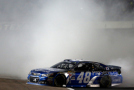 Jimmie Johnson, driver of the #48 Lowe's Pro Services Chevrolet, celebrates with a burnout after winning the NASCAR Sprint Cup Series Duck Commander 500 at Texas Motor Speedway on April 11, 2015 in Fort Worth, Texas. - Photo Credit: Tom Pennington/Getty Images