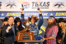 Jimmie Johnson, driver of the #48 Lowe's Pro Services Chevrolet, celebrates with pistols, presented by Texas Motor Speedway President Eddie Gossage, left, in Victory Lane after winning the NASCAR Sprint Cup Series Duck Commander 500 at Texas Motor Speedway on April 11, 2015 in Fort Worth, Texas. - Photo Credit: Chris Graythen/Getty Images