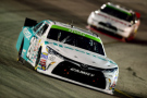 Denny Hamlin, driver of the #20 Hisense Toyota, leads Joey Logano, driver of the #22 Discount Tire Ford, during the NASCAR XFINITY Series ToyotaCare 250 at Richmond International Raceway on April 24, 2015 in Richmond, Virginia. - Photo Credit: Jared C. Tilton/Getty Images