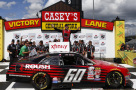Chris Buescher, driver of the #60 Roush Performance Products Ford, celebrates in victory lane after winning during the NASCAR XFinity Series 3M 250 at Iowa Speedway on May 17, 2015 in Newton, Iowa. - Photo Credit: Jeff Zelevansky/Getty Images