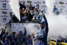 Jimmie Johnson, driver of the #48 Lowe's Pro Services Chevrolet, celebrates in Victory Lane after winning the NASCAR Sprint Cup Series FedEx 400 Benefiting Autism Speaks at Dover International Speedway on May 31, 2015 in Dover, Delaware. - Photo Credit: Todd Warshaw/Getty Images