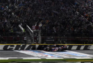 Denny Hamlin, driver of the #11 FedEx Express Toyota, takes the checkered flag as he crosses the finish line to win the NASCAR Sprint Cup Series Sprint All-Star Race at Charlotte Motor Speedway on May 16, 2015 in Charlotte, North Carolina. - Photo Credit: Rainier Ehrhardt/Getty Images