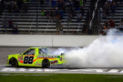 Matt Crafton, driver of the #88 Ideal Door/Menards Toyota, celebrates with a burnout after winning the NASCAR Camping World Truck Series WinStar World Casino & Resort 400 at Texas Motor Speedway on June 5, 2015 in Fort Worth, Texas. - Photo Credit: Robert Laberge/Getty Images