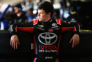 Erik Jones, driver of the #4 Special Olympics World Games Toyota, stands in the garage area during practice. - Photo Credit: Sean Gardner/Getty Images
