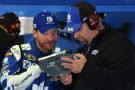 """Dale Earnhardt Jr., driver of the #88 Nationwide Chevrolet, left, looks over data with a crew member in the garage area during practice for the NASCAR Sprint Cup Series Axalta """"We Paint Winners"""" 400 at Pocono Raceway on June 5, 2015 in Long Pond, Pennsylvania. Photo Credit: Drew Hallowell/Getty Images"""
