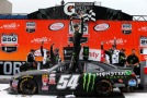 Kyle Busch, driver of the #54 Monster Energy Toyota, celebrates in victory lane after winning the NASCAR XFINITY Series Great Clips 250 Benefiting Paralyzed Veterans of America at Michigan International Speedway on June 13, 2015 in Brooklyn, Michigan. - Photo Credit: Brian Lawdermilk/Getty Images