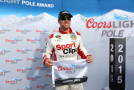 Carl Edwards, driver of the #19 Sport Clips Toyota, poses with the Coors Light Pole Award after qualifying for pole position for the NASCAR Sprint Cup Series 5-Hour Energy 301 at New Hampshire Motor Speedway on July 17, 2015 in Loudon, New Hampshire. - Photo Credit: Maddie Meyer/Getty Images