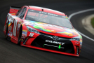 Kyle Busch drives the #18 Skittles Toyota during the NASCAR Sprint Cup Series Crown Royal Presents the Jeff Kyle 400 at the Brickyard at Indianapolis Motor Speedway on July 26, 2015 in Indianapolis, Indiana. - Photo Credit: Jerry Markland/Getty Images