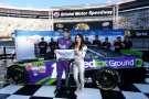 Denny Hamlin, driver of the #11 FedEx Ground Toyota, poses with Miss Coors Light Amanda Mertz and the Coors Light Pole award after qualifying for pole position for the NASCAR Sprint Cup Series Irwin Tools Night Race at Bristol Motor Speedway on August 21, 2015 in Bristol, Tennessee. - Photo Credit: Rainier Ehrhardt/Getty Images
