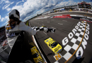 Kyle Busch, driver of the #51 Dollar General Toyota, takes the checkered flag to win the NASCAR Camping World Truck Series Pocono Mountains 150 at Pocono Raceway on August 1, 2015 in Long Pond, Pennsylvania. - Photo Credit: Todd Warshaw/Getty Images