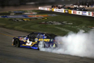 Chase Elliott, driver of the #9 NAPA Auto Parts Chevrolet, celebrates with a burnout after winning the NASCAR XFINITY Series Virginia529 College Savings 250 at Richmond International Raceway on September 11, 2015 in Richmond, Virginia. - Photo Credit: Matt Sullivan/Getty Images
