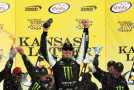 Kyle Busch, driver of the #54 Monster Energy Toyota, celebrates in Victory Lane after winning the NASCAR XFINITY Series Kansas Lottery 300 at Kansas Speedway on October 17, 2015 in Kansas City, Kansas. - Photo Credlt: Todd Warshaw/Getty Images