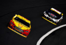 Joey Logano, driver of the #22 Shell Pennzoil Ford, leads Kevin Harvick, driver of the #4 Jimmy John's/Budweiser Chevrolet, during the NASCAR Sprint Cup Series Bank of America 500 at Charlotte Motor Speedway on October 11, 2015 in Charlotte, North Carolina. - Photo Credit: Josh Hedges/Getty Images