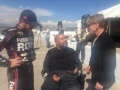 L-R Martin Truex Jr., Stewart Lundy and Dr. Scott Falci discuss the excitement of Lundy's ride with Truex in an adaptive race car Wednesday (Oct. 7) at Pikes Peak International Raceway.