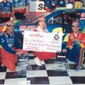 Jeff Gordon (right), Miss Winston (center) and Crew Chief Ray Evernham (left) celebrate in Victory Lane for their first win at Talladega Superspeedway in 1996.