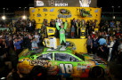 Kyle Busch, driver of the #18 M&M's Crispy Toyota, celebrates winning the series championship and the race in Victory Lane after the NASCAR Sprint Cup Series Ford EcoBoost 400 at Homestead-Miami Speedway on November 22, 2015 in Homestead, Florida. - Photo Credit: Sean Gardner/Getty Images