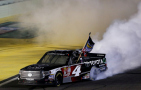 Erik Jones, driver of the #4 Toyota, celebrates with a burnout after winning after winning the series championship after the NASCAR Camping World Truck Series Ford EcoBoost 200 at Homestead-Miami Speedway on November 20, 2015 in Homestead, Florida. - Photo Credit: Jonathan Ferrey/Getty Images